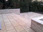 Ely, Cambridgeshire: Patio, steps and inset lighting with co-ordinating retaining wall
